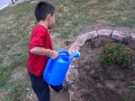 1st Grade students at Quindaro Elementary water their fall bulb plantings